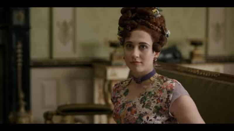 Philipa (Harriet Cains) as a gentleman comes to the house