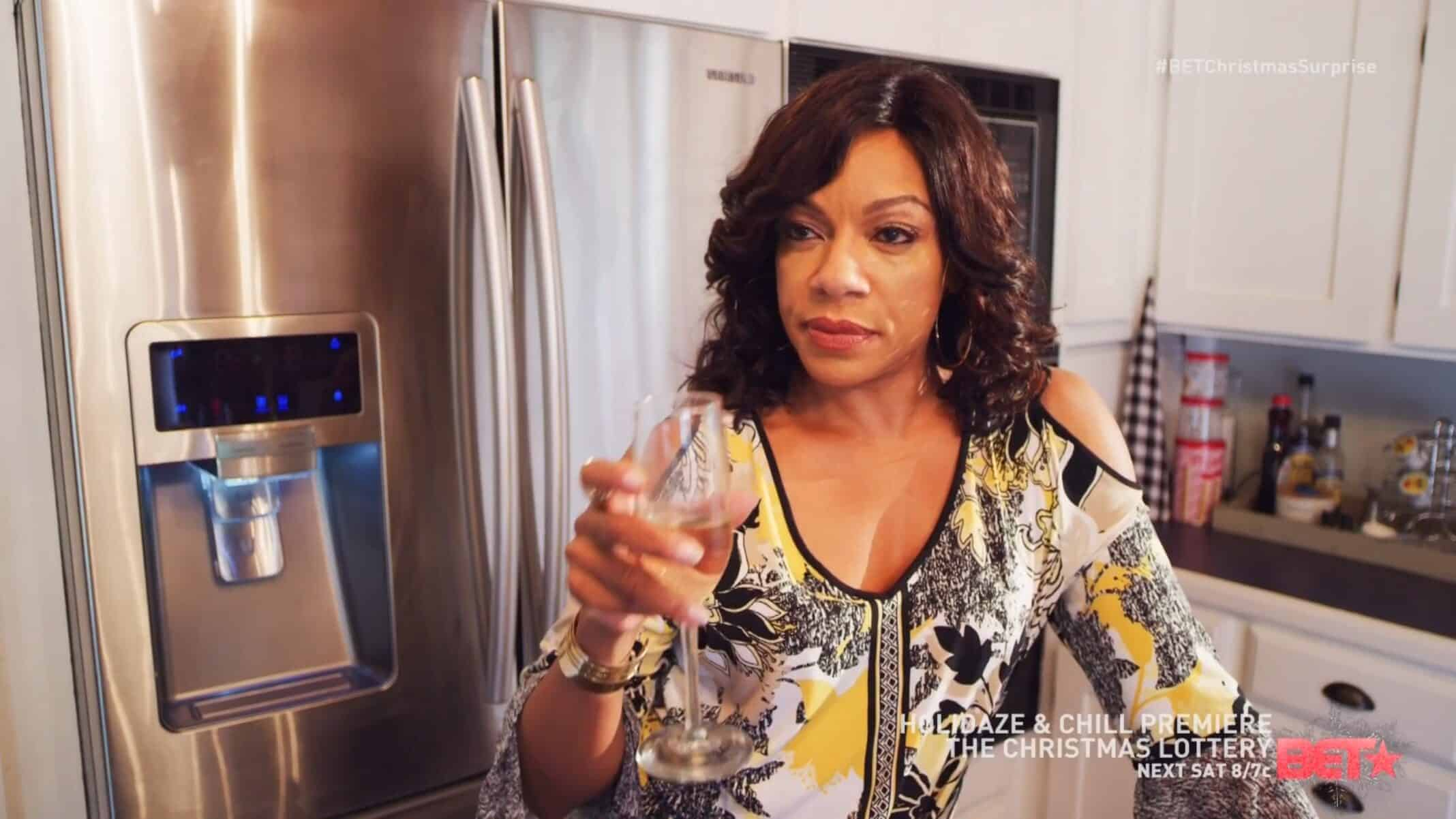 Tanya (Wendy Raquel Robinson) with a drink in hand