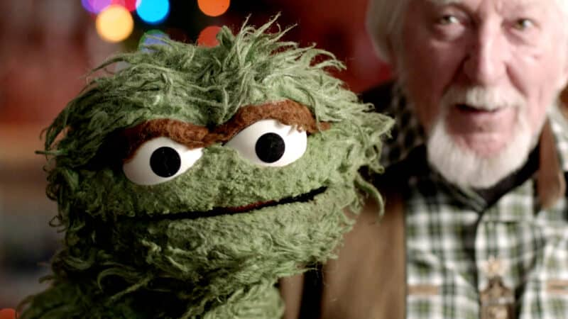 Caroll Spinney showing off Oscar the Grouch