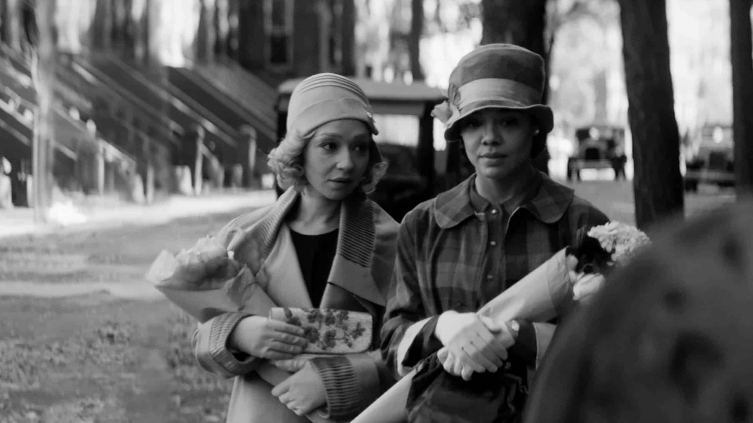 Clare (Ruth Negga) and Irene (Tessa Thompson) walking together on the street