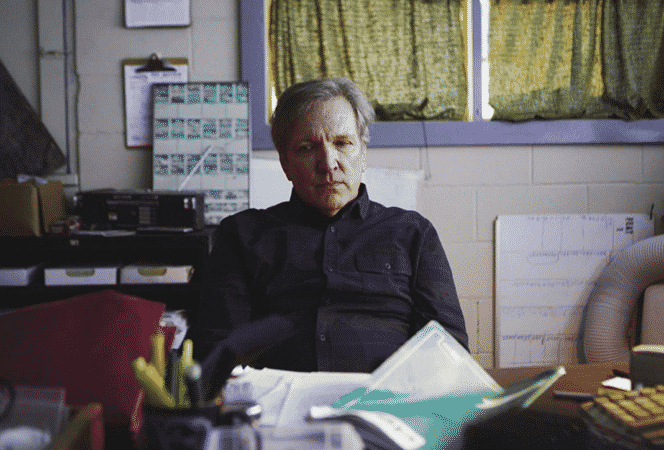 Doug (Martin Donovan) sitting in his office