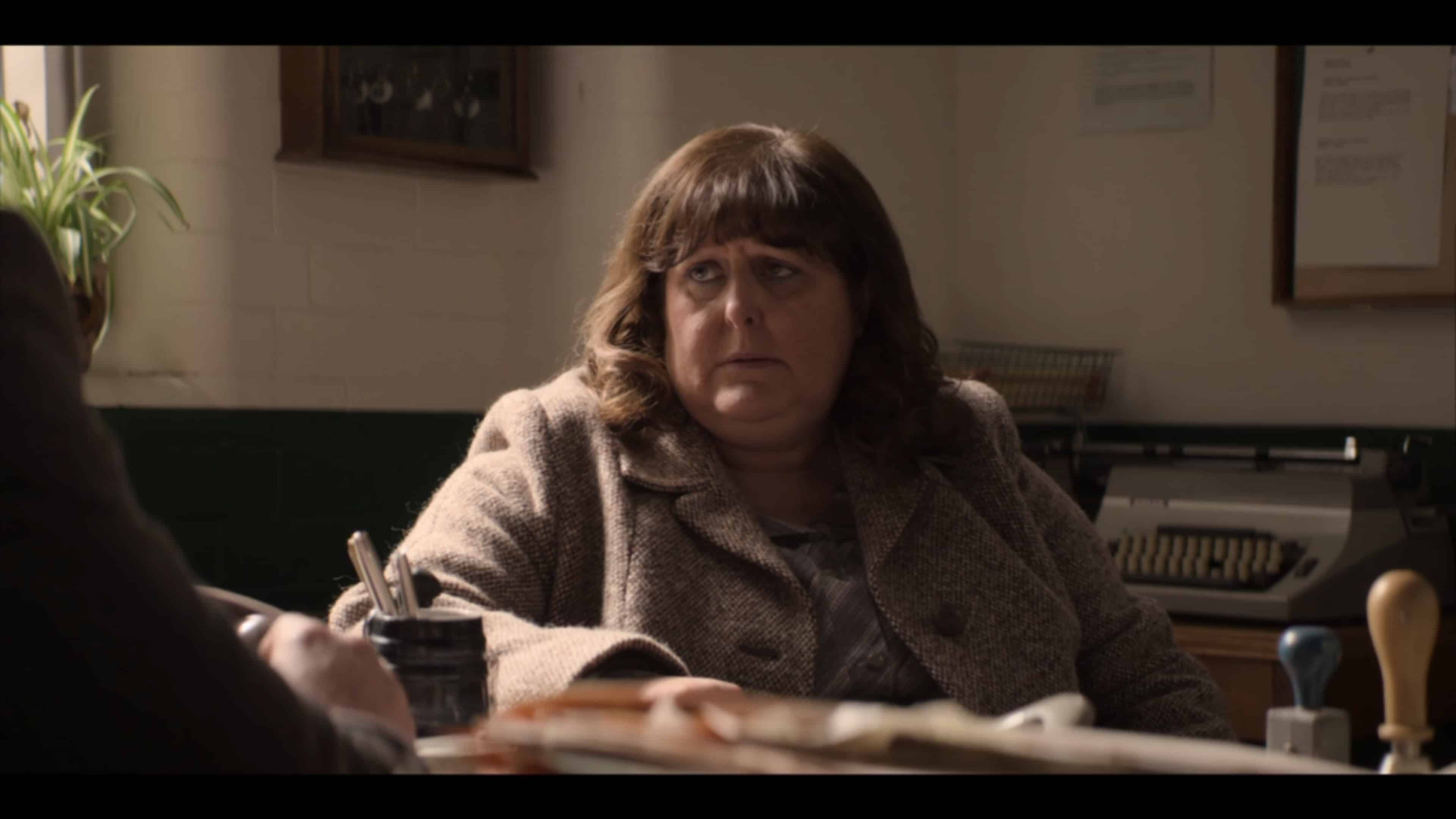 Eileen (Andria Doherty) learning her son is locked up