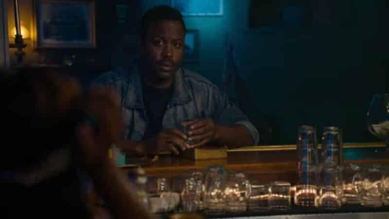 George (Kevin Daniels) sitting at a bar