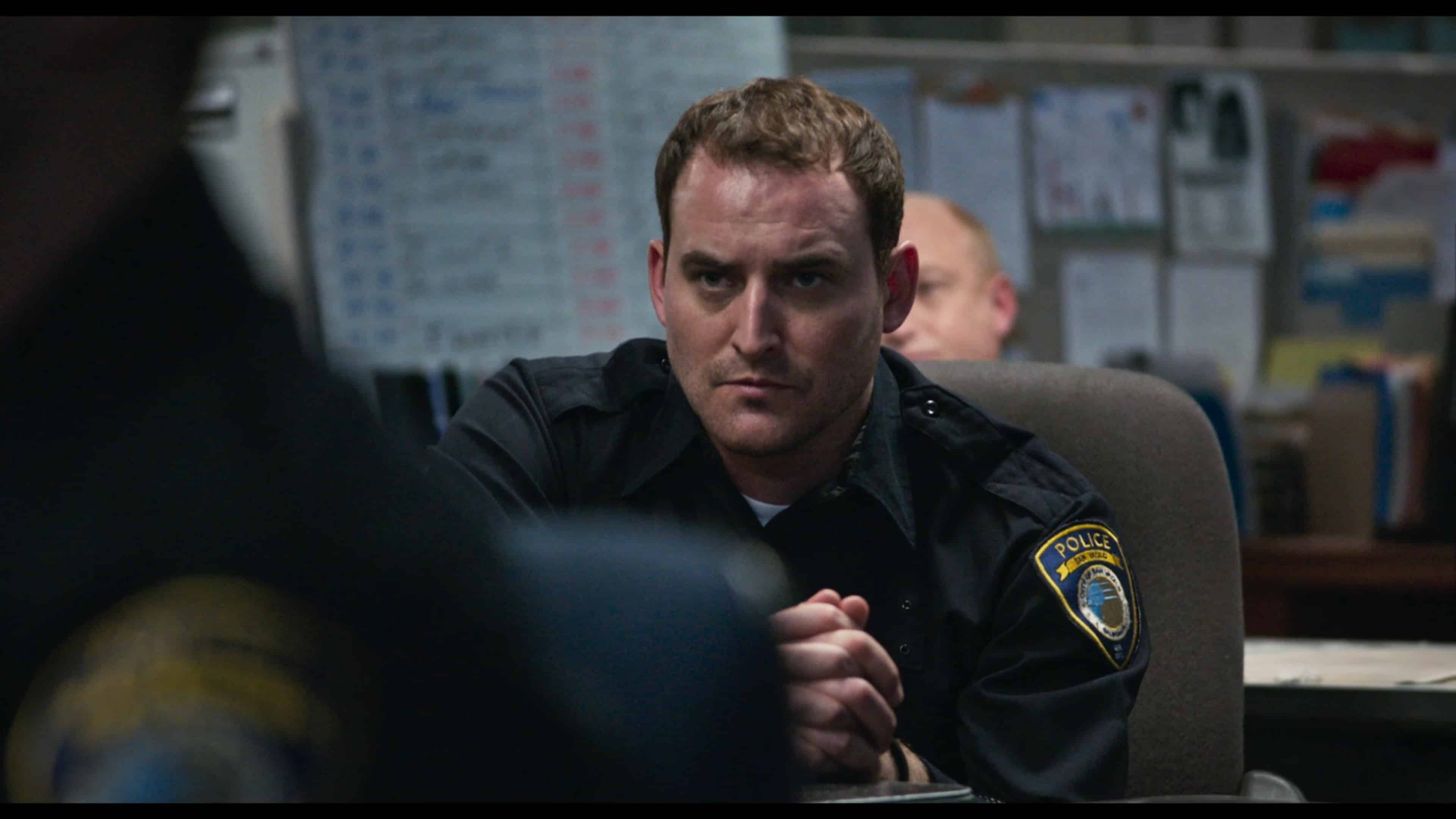 Officer Hollander (Ryan Mulkay) in a hostage situation