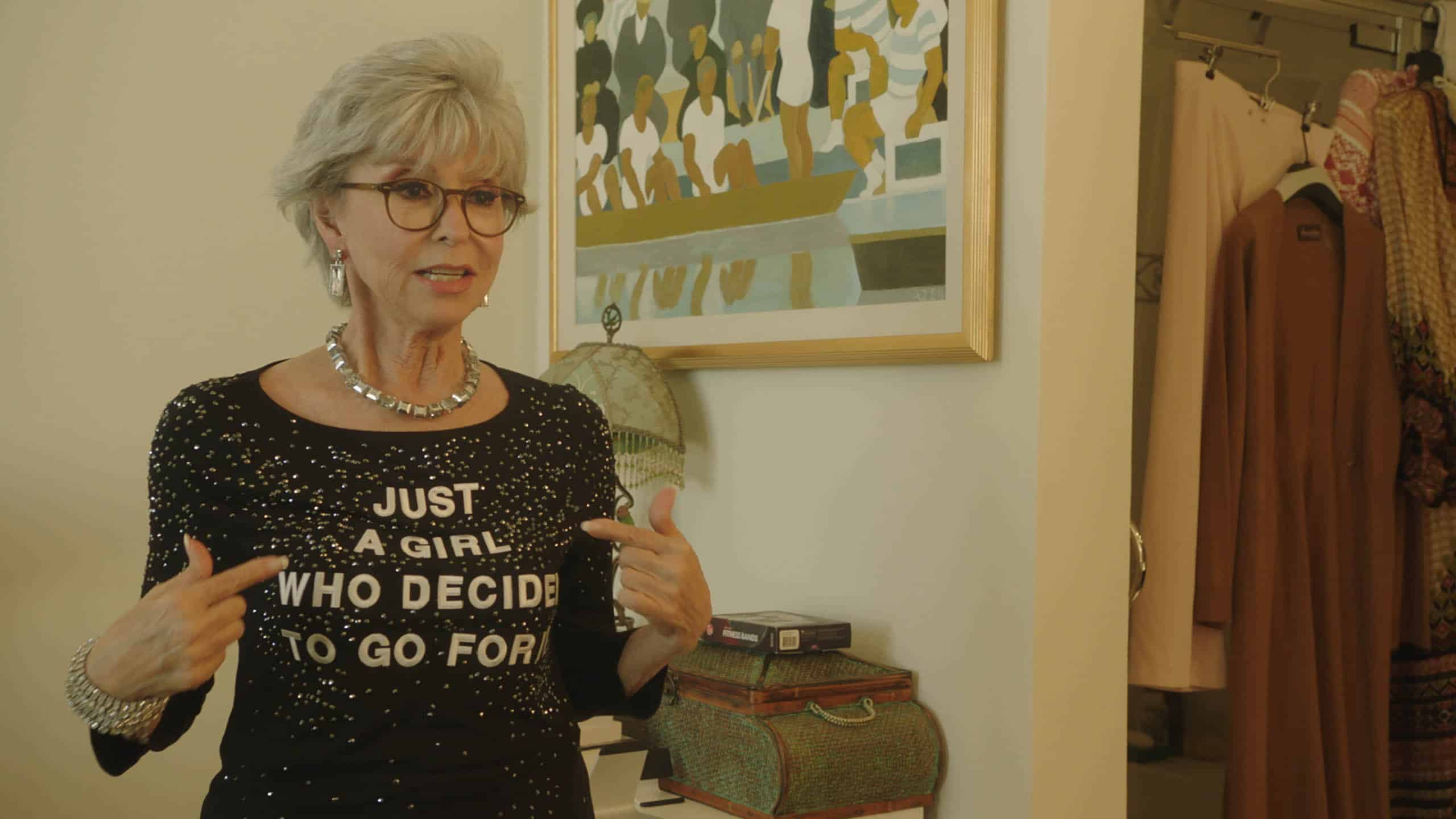 Rita Moreno with a shirt on that says the title of the movie