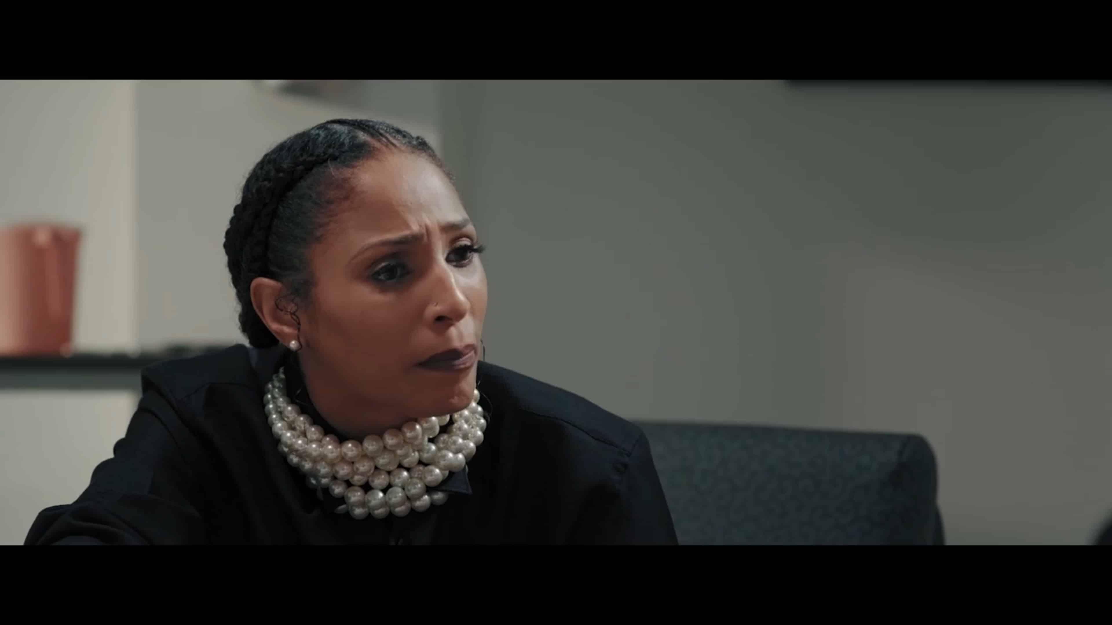 Tanya (Candice Van Beauty) talking to her husband, Detective Ryan