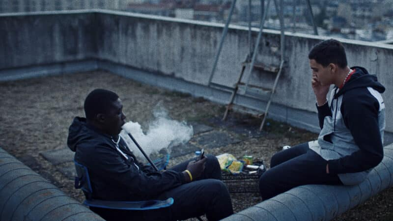 Aladi (Mouctar Diawara) and Ismael (Zakaria Lazab) hanging out on a roof