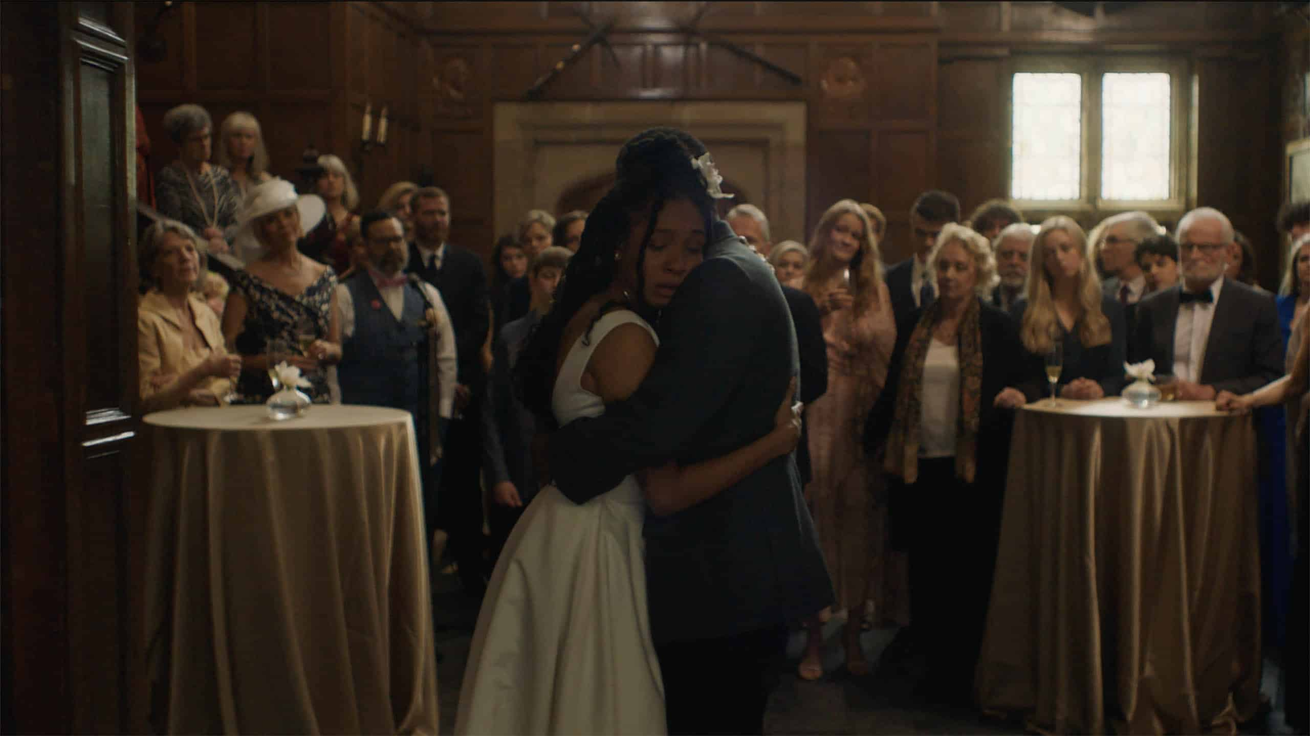 Bella (Nabiyah Be) and Bower (Curtiss Cook) hugging at Bella's wedding