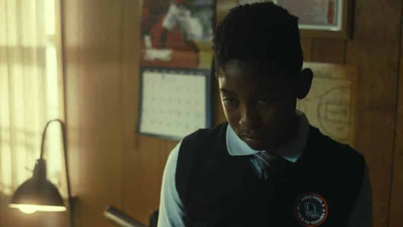 Darius (Noble B. Whitted) in his school uniform