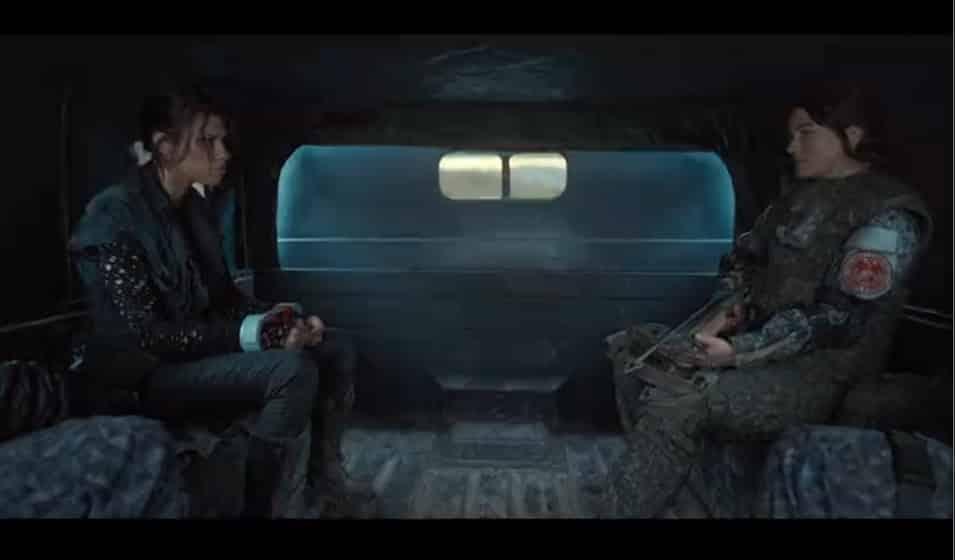 Grieta and Liv in a Crimson vehicle