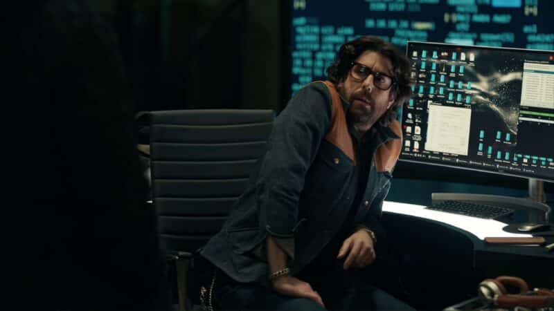 Harry (Adam Goldberg) hunched over his desk