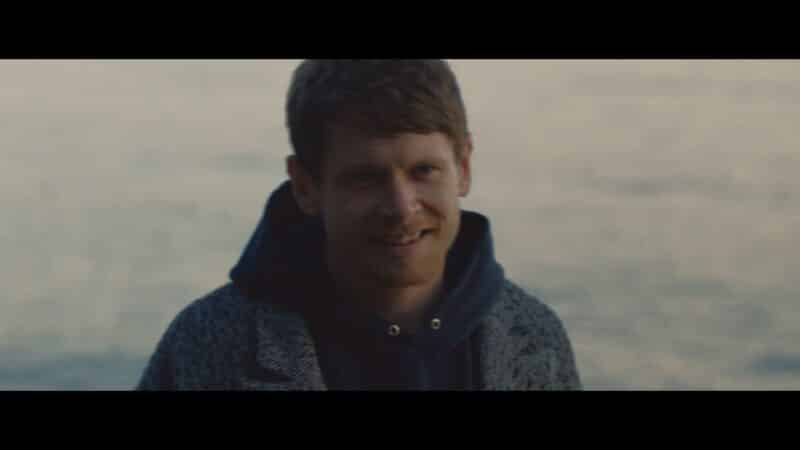 Jude (Jack O'Connell) smiling