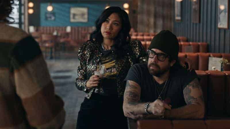 Melody (Liza Lapira) and Harry (Adam Goldberg) listening ot Robyn