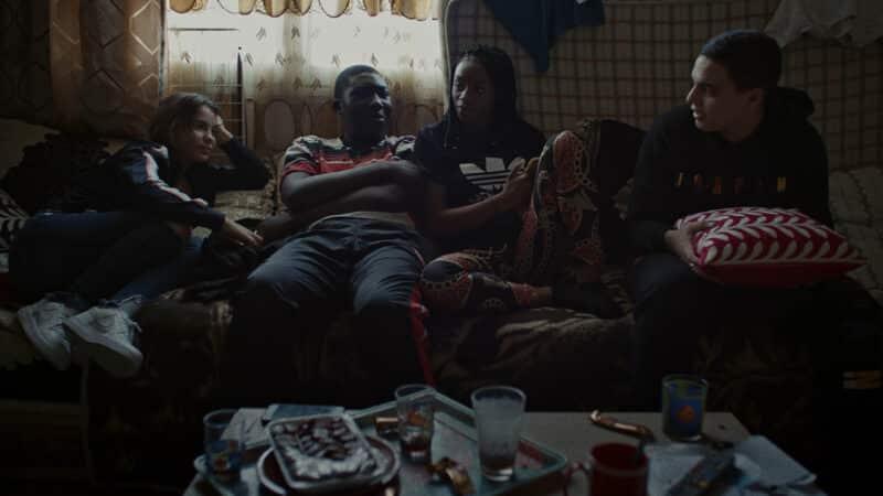 Shaiou (Shirel Nataf), Aladi (Mouctar Diawara), Djeneba (Fanta Kebe), and Ismael (Zakaria Lazab) hanging out