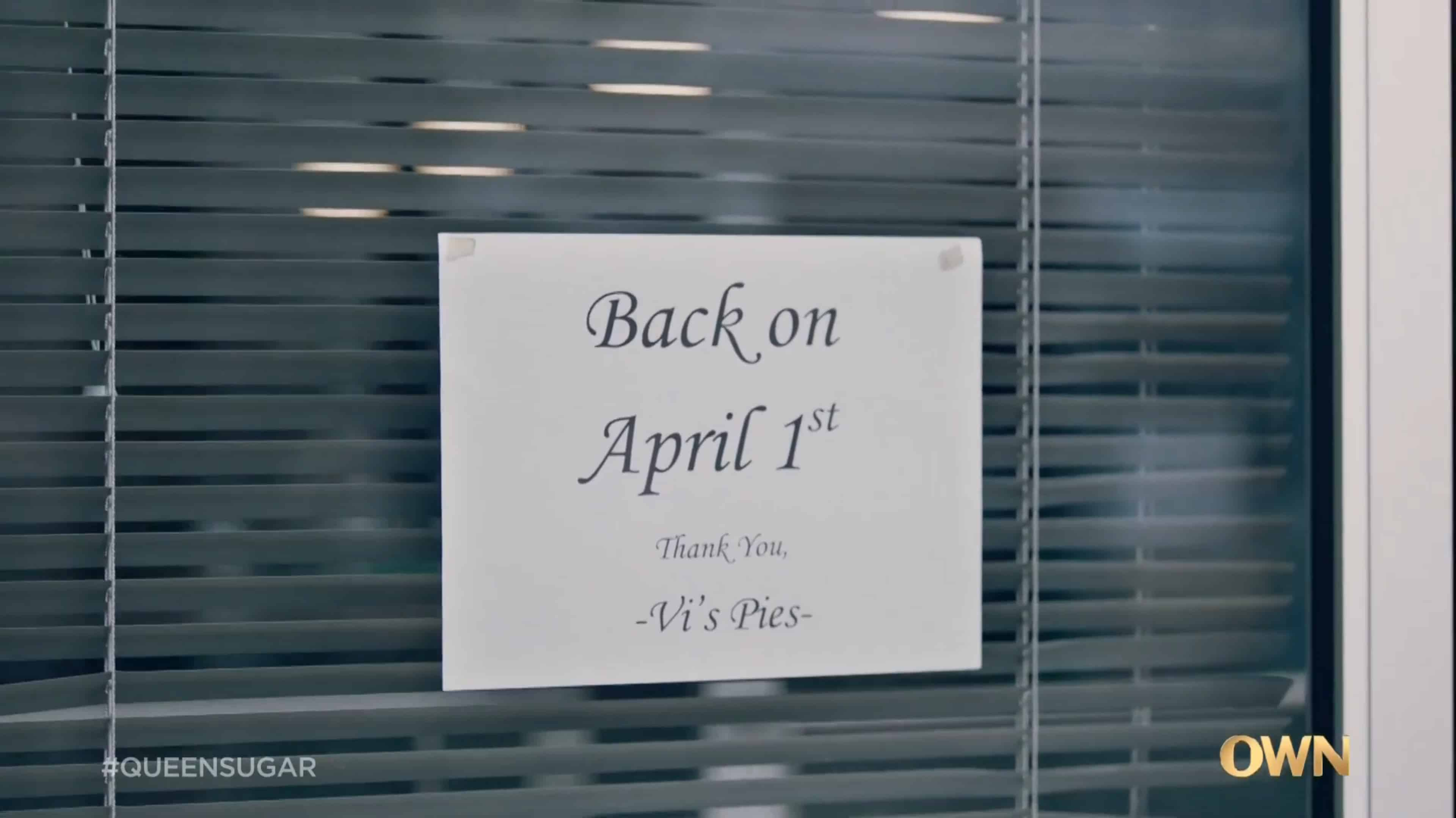 A sign outside of Aunt Vi's pie shop noting they'll be back April 1st
