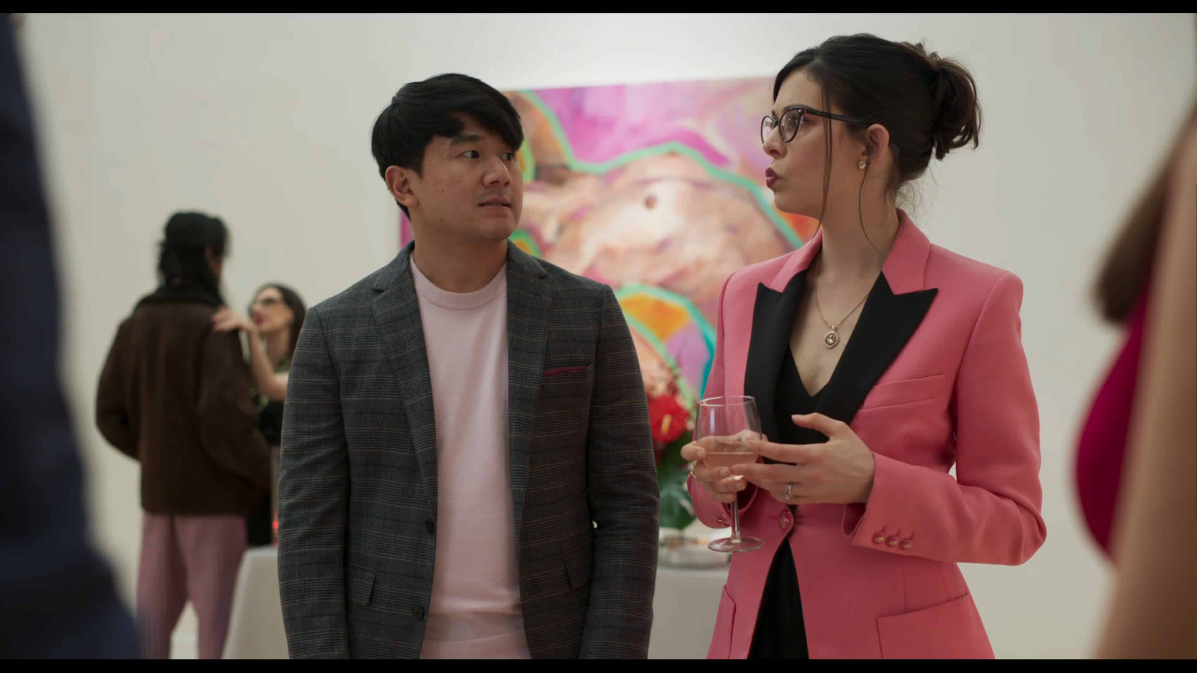 Adam (Ronny Chieng) and Eleanor (Lindsey Broad) at Brooke's gallery opening