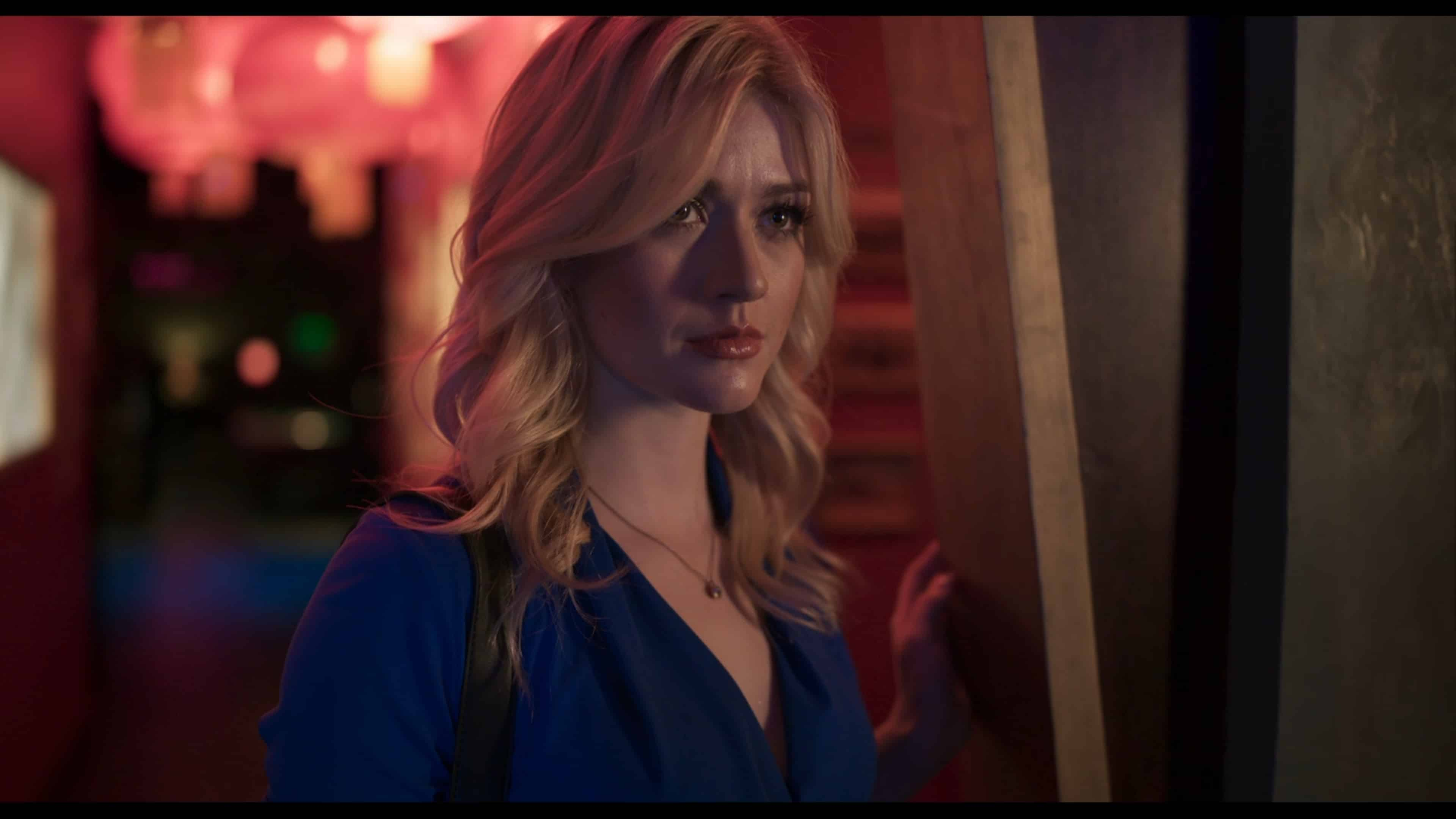 Amy (Katherine McNamara) prepping to get Owen in bed