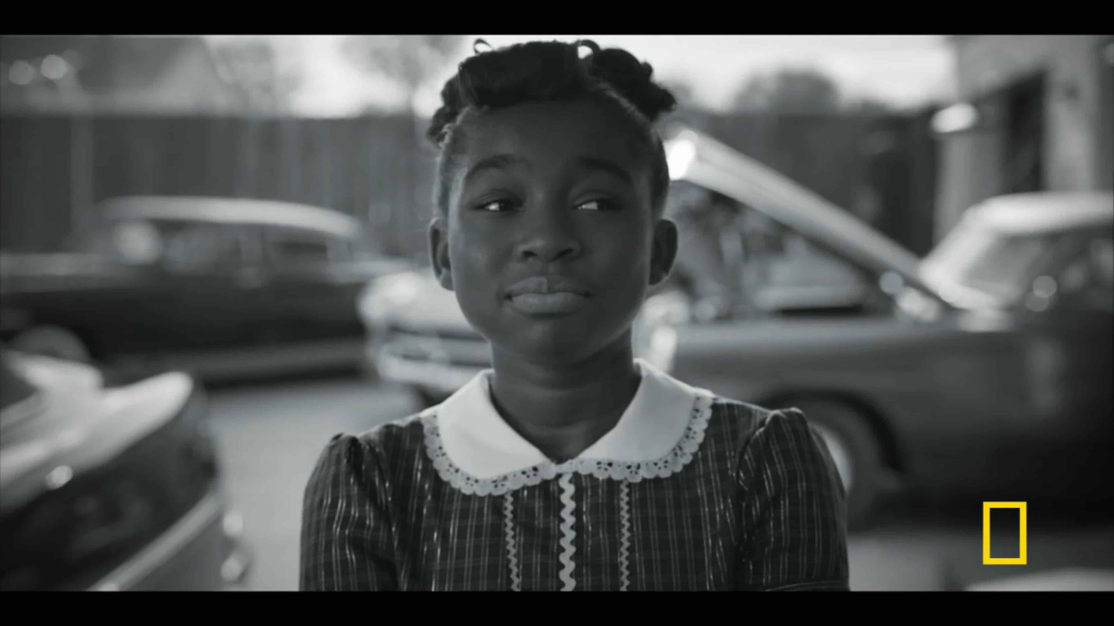 Aretha Louise (Shaian Jordan) watching her dad buy a new car with cash