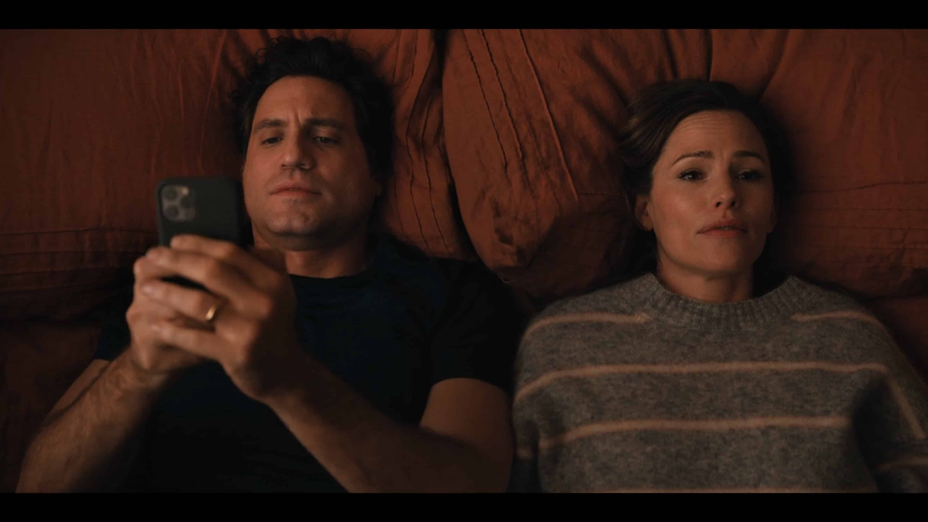 Carlos (Edgar Ramirez) and Allison (Jennifer Garner) in bed after a long day