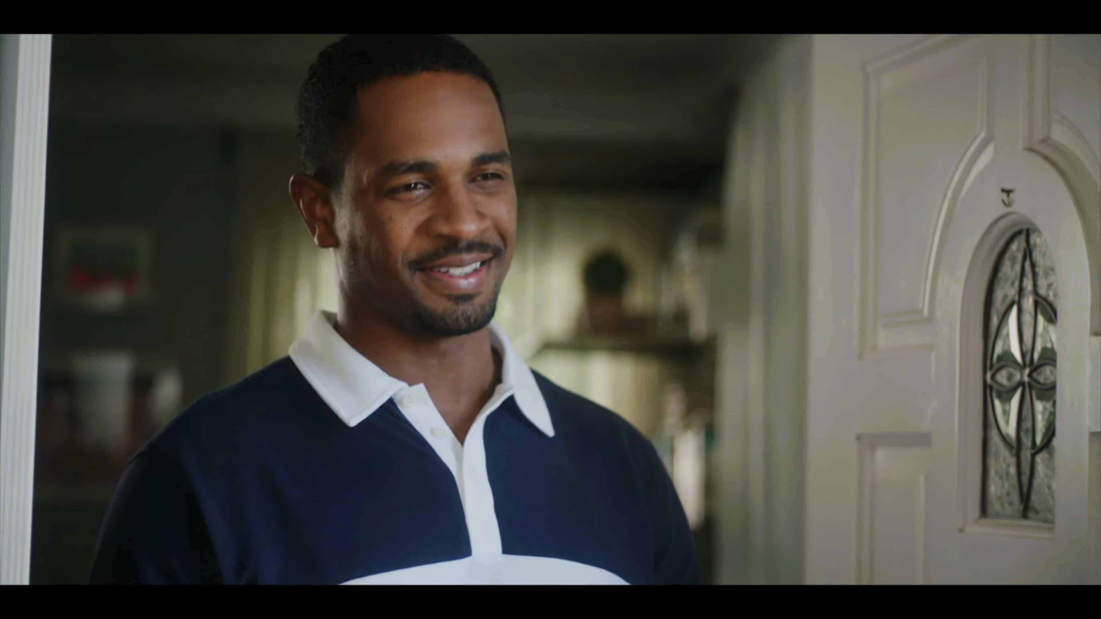Doug (Damon Wayans Jr.) smiling, answering his door