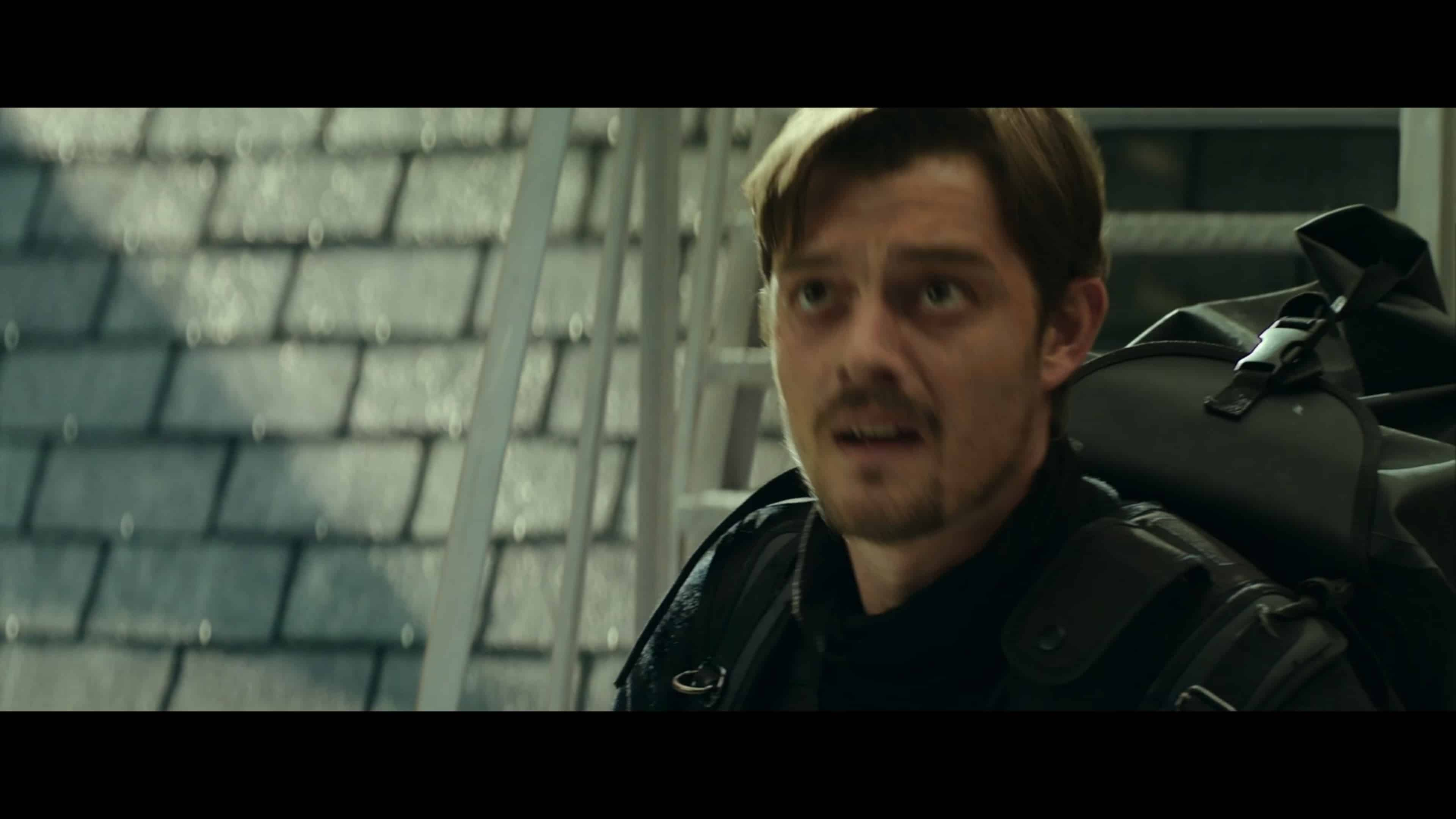 James (Sam Riley) waiting for Lorraine and Thomas to use the zipline to his location