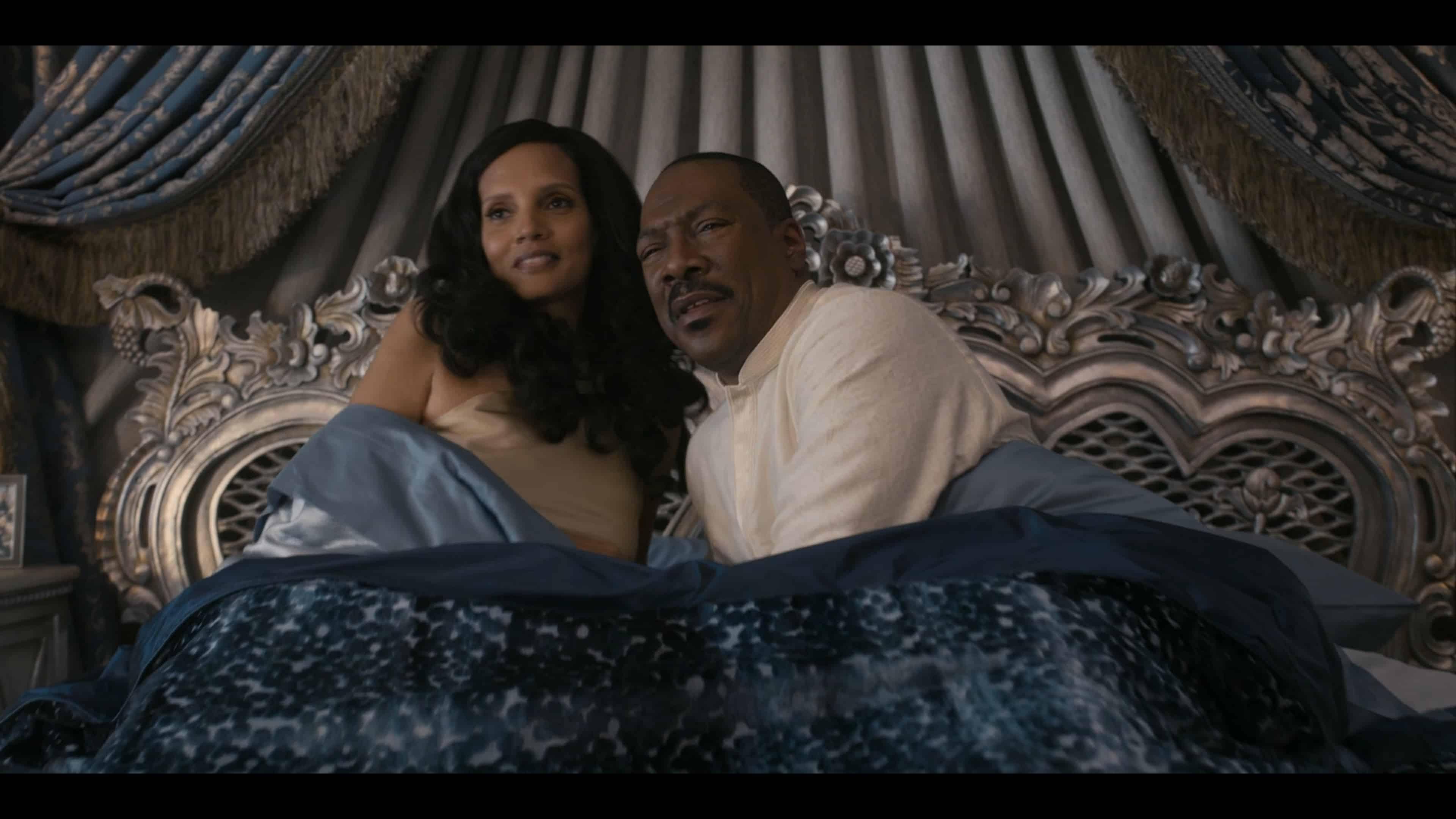 Lisa (Shari Headley) and Akeem (Eddie Murphy) in bed together