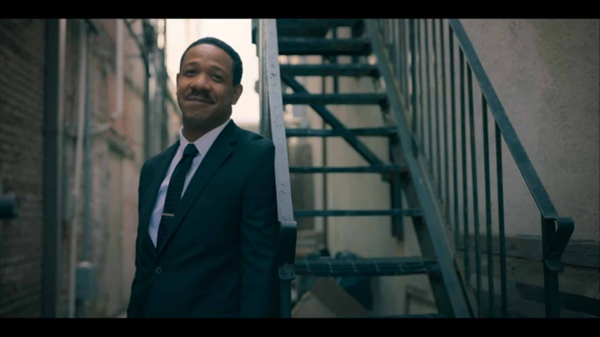 Martin Luther King Jr. (Ethan Henry) watching Aretha walk away with a smile