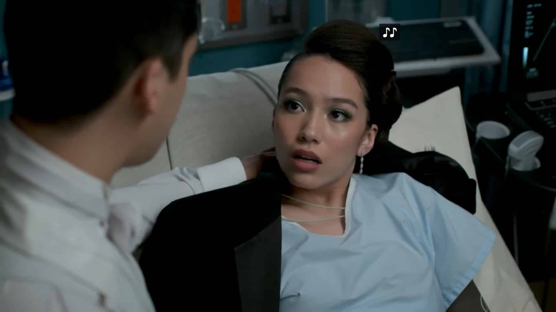 Maya (Jasmine Vega) in a hospital bed