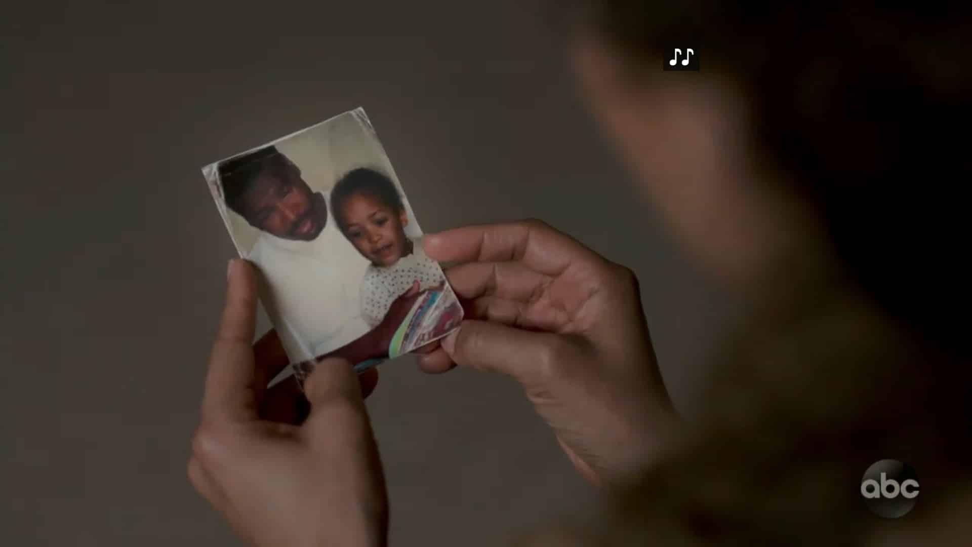 A picture of Miles with a young Claire, in a wrinkled photo.