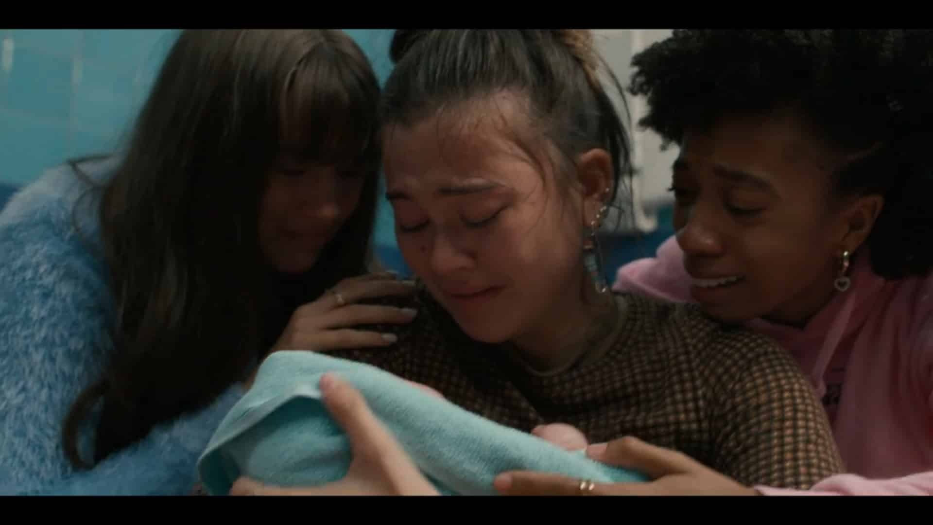 Naomi, Delilah, and Arianna looking at Delilah's just born baby