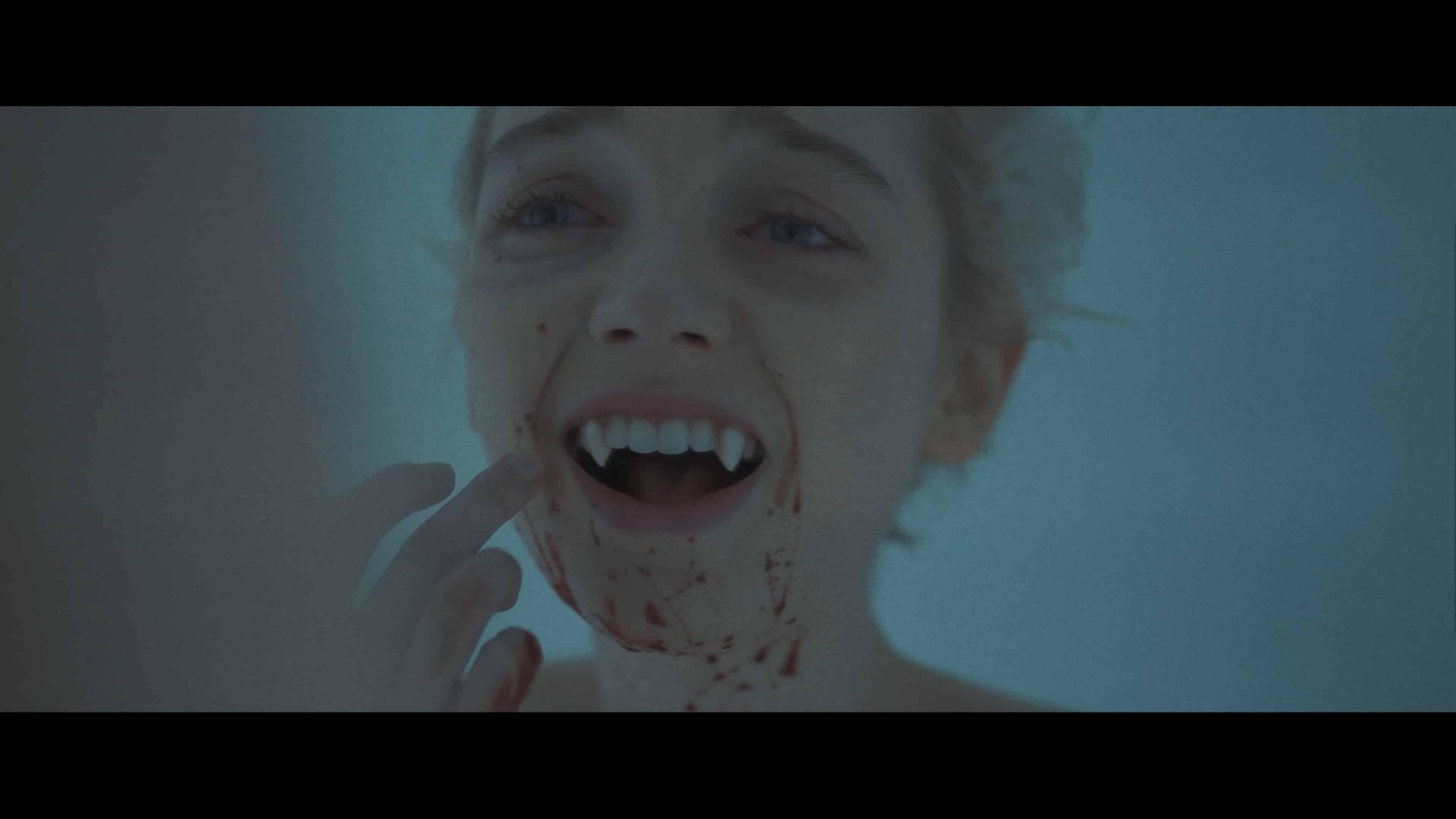 Sarah (Juliah Sarah Stone) discovering she has vampire fangs