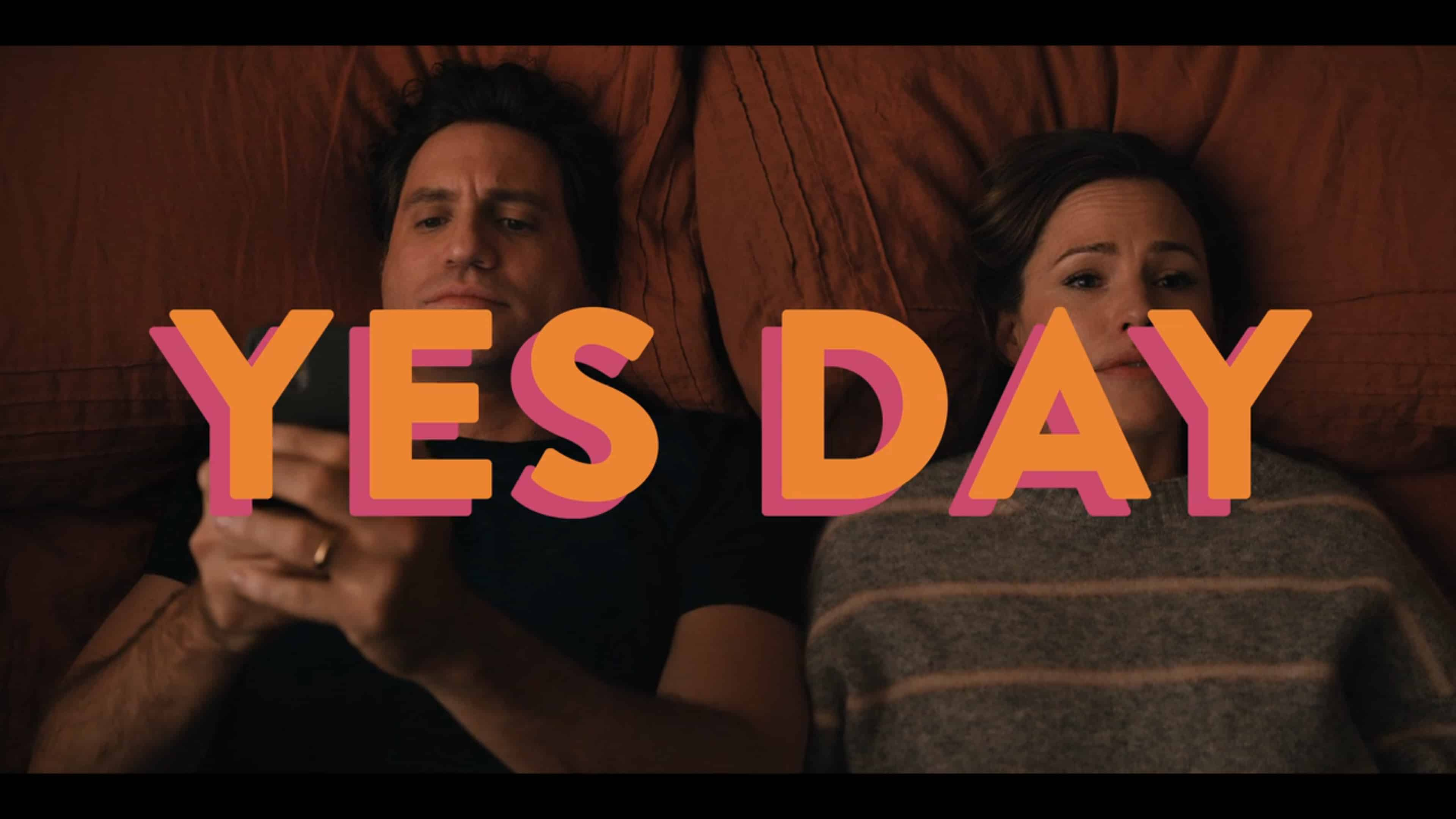 Carlos (Edgar Ramirez) and Allison (Jennifer Garner) on the bed, with Carlos on his phone