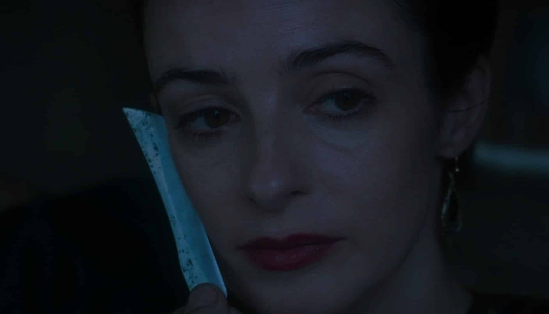 Amalia with the Beggar King's blade on her cheek