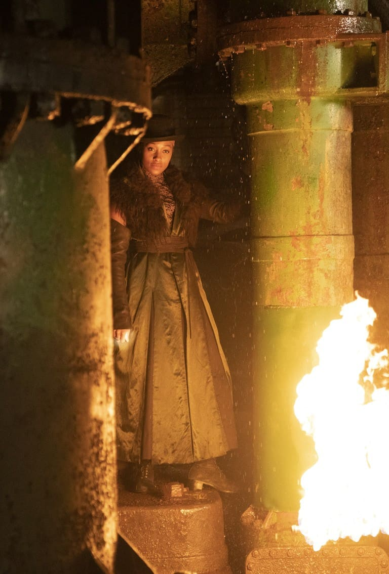 Annie 'Bonfire' Carby (Rochelle Neil) illuminated by fire