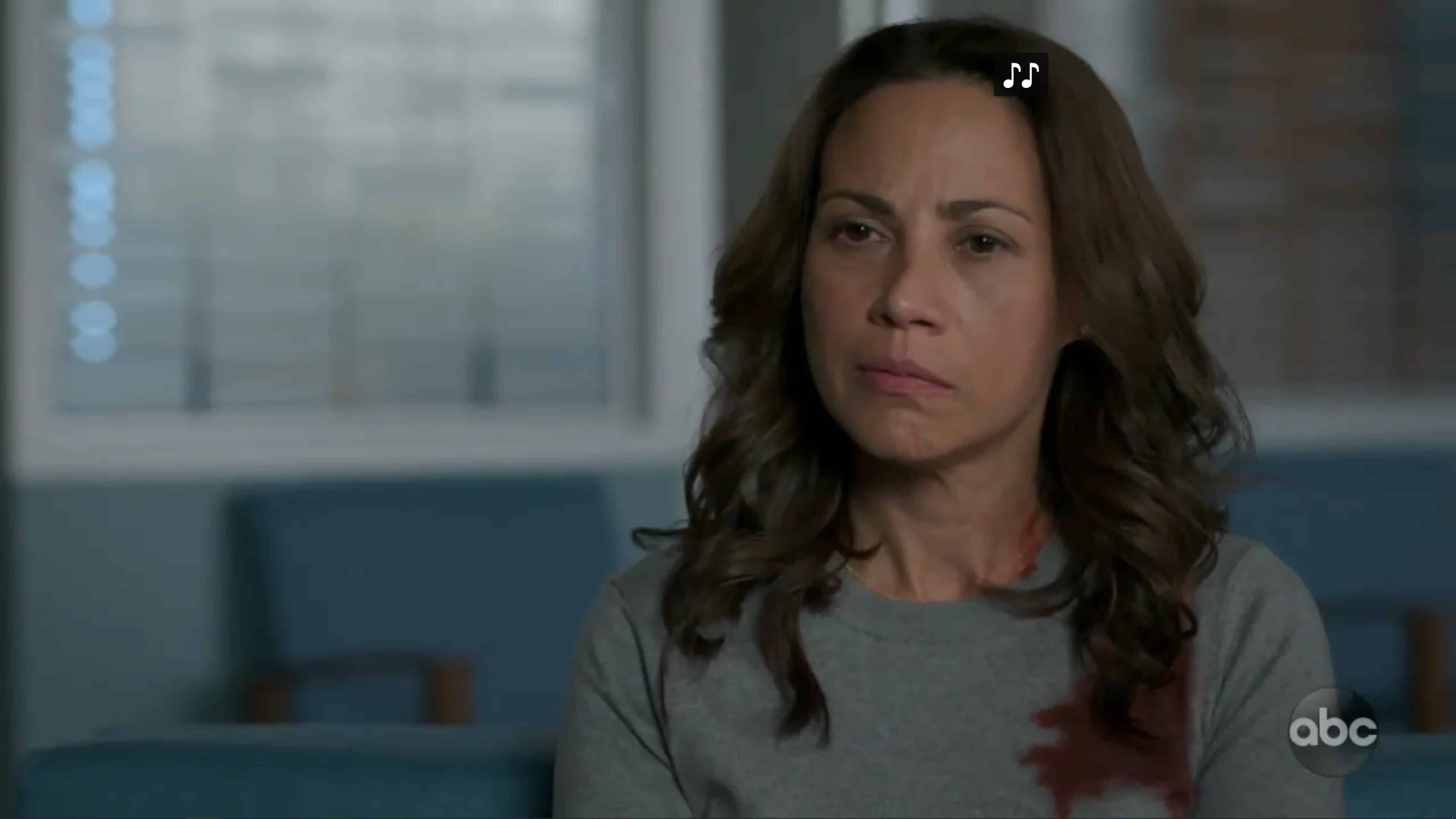 Carina (Elizabeth Rodriguez) waiting for an update on her son