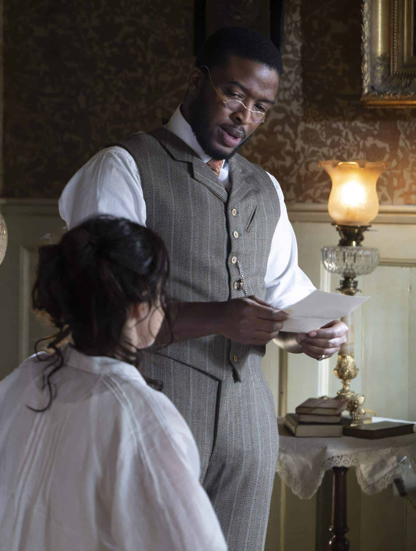 Dr. Horatio Cousens (Zackary Momoh) with a patient