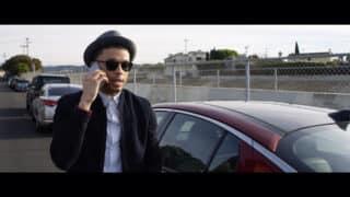 Justin (Roland Buck III) on the phone