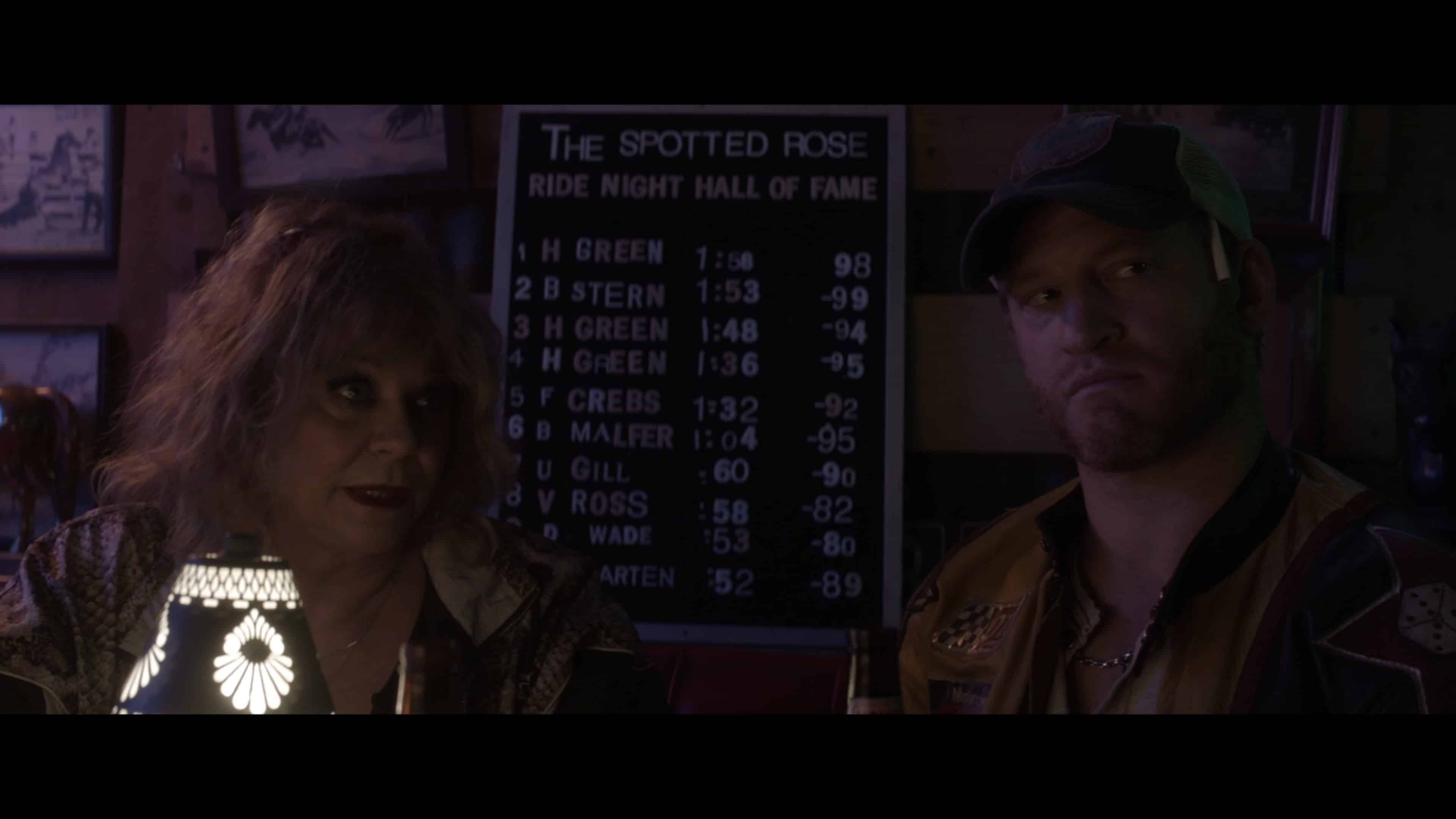 Ma Voss (Jeanette O'Connor) and Danny (Brent Chase) making a deal with Herb