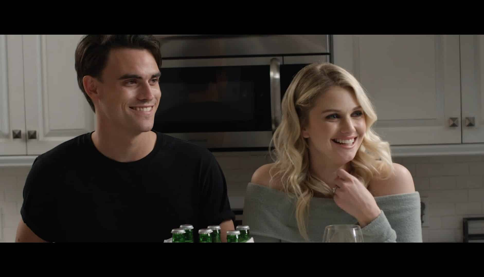 Zachary (Jonathan D. King) and Kate (Katie Gill) laughing in the kitchen