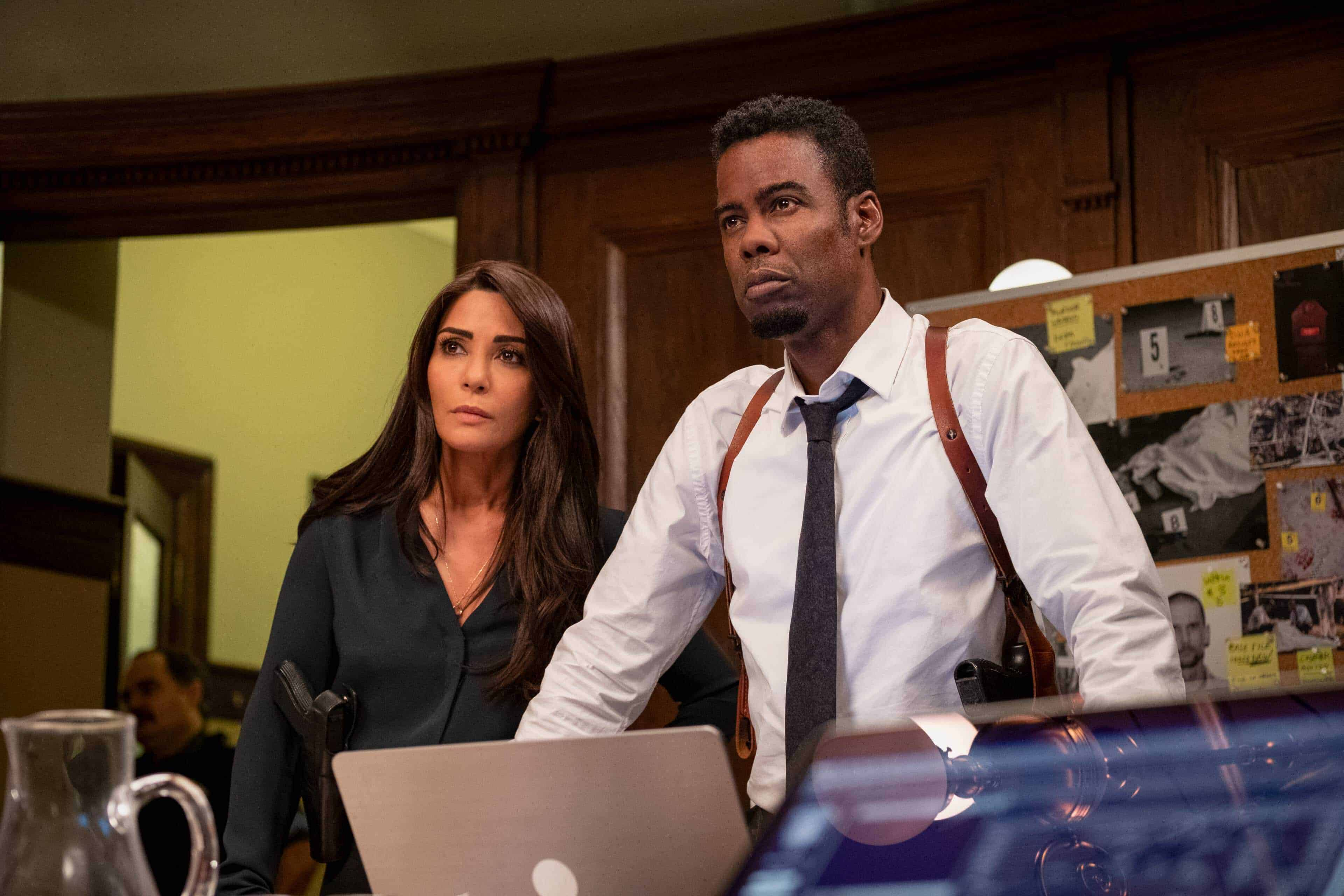 Angie (Marisol Nichols) and Zeke (Chris Rock) looking at the evidence