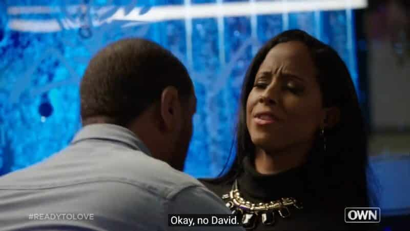 David trying to kiss Liz and her dodging that