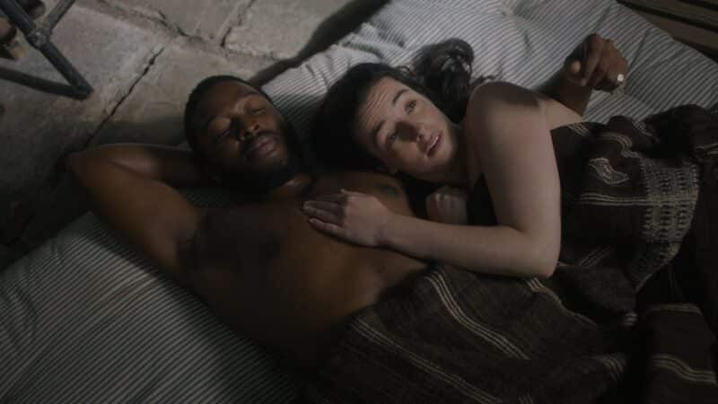 Dr. Cousens and Amalia in bed together