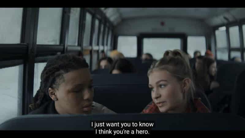 Jake and Dakota (Katelyn Wagner) talking on the bus