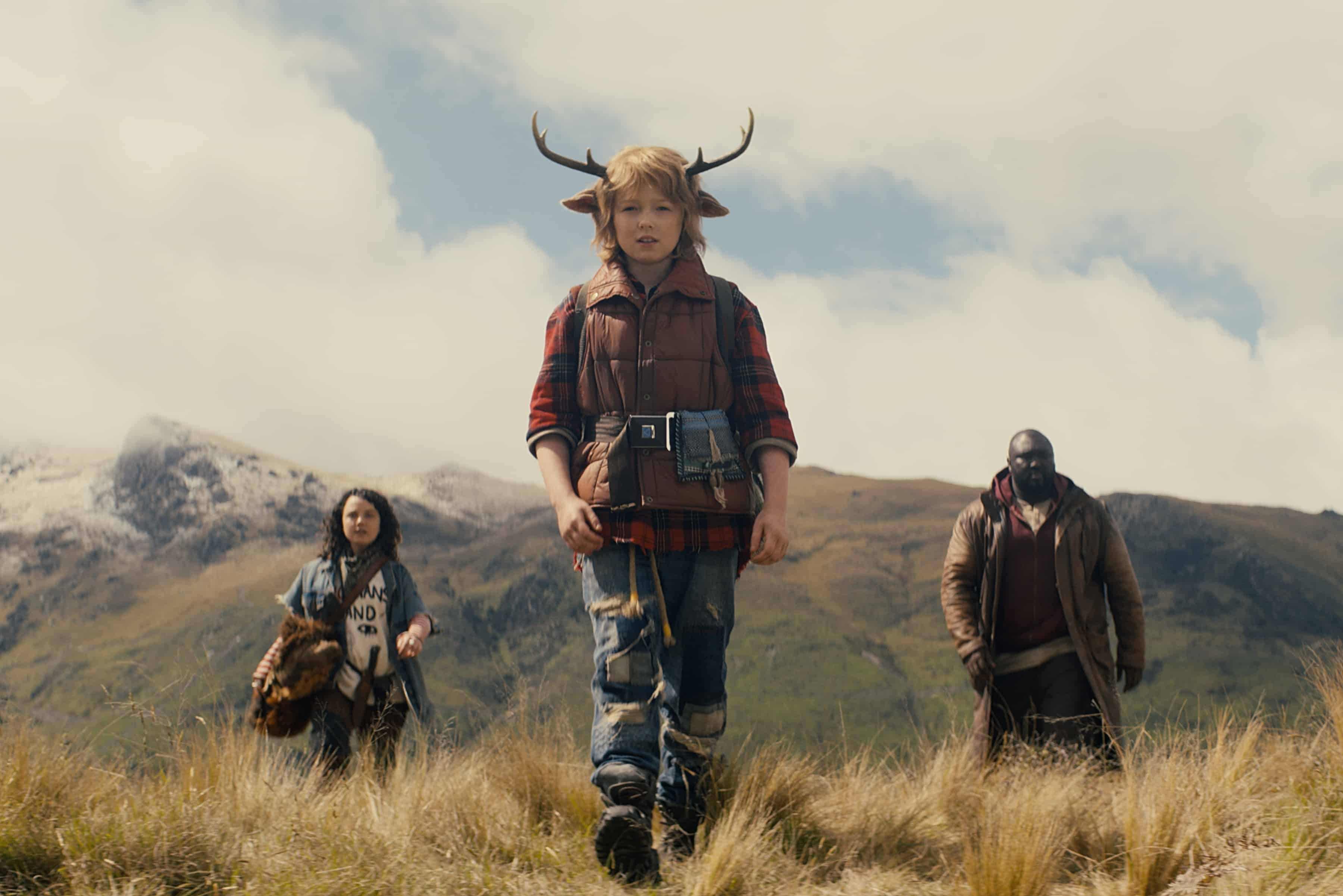 Bear (Stefania LaVie Owen), Gus (Christian Convery), and Tommy (Nonso Anozie) in a field