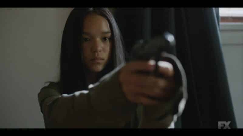 Brittany playing with Ray's gun