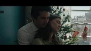 Fred (Dylan O'Brien) holding Karen (Hannah Gross) from behind