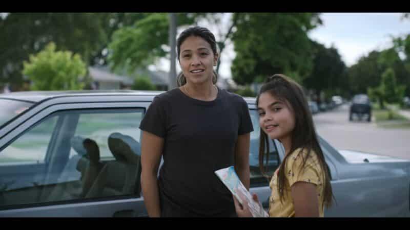 Jill (Gina Rodriguez) and Matilda (Ariana Greenblatt) when Jill comes to pick up her kids