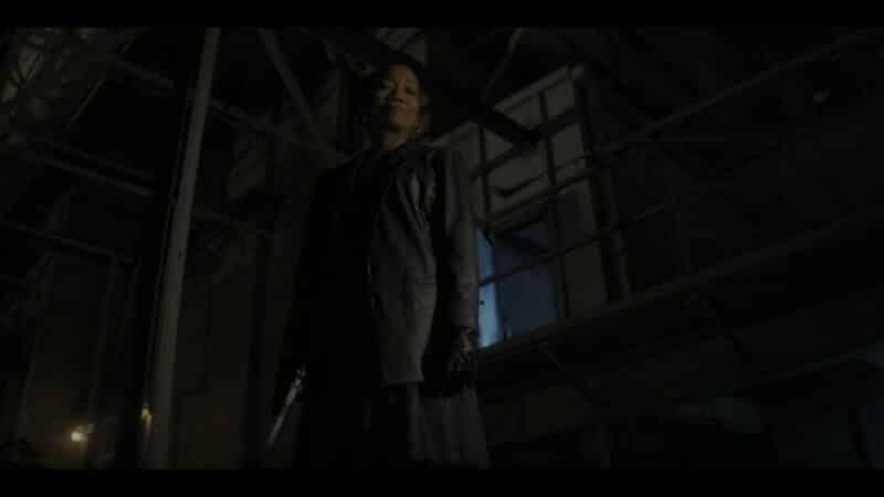 Laverne standing over Otis' body, after shooting him