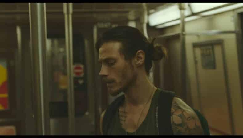 Lee (McCaul Lombardi) on the subway car he meets Paul on