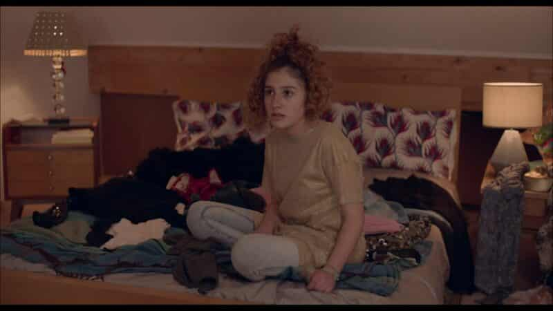 Marie (Malonn Levana) on her bed